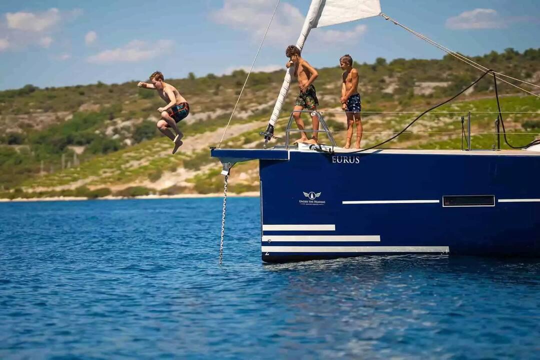 Kids Jumping into Ocean on Family Sailing Vacation | Sebastus Sailing