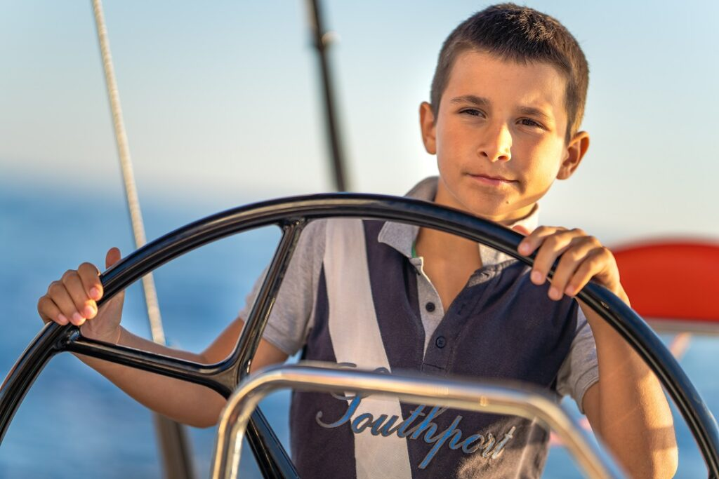 kids sailing, boating with a toddler, young kid on a yacht, sailing activities for kids, family sailing adventure